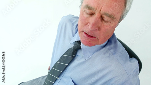 Businessman having back troubles