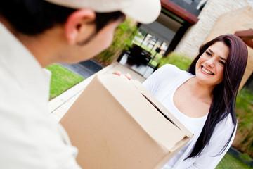 Mailman delivering a parcel