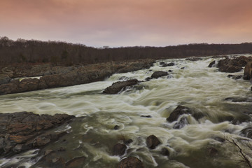 White water river and stormy sky