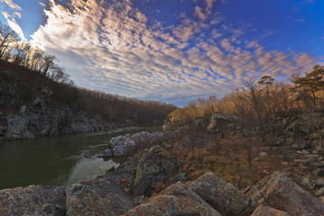 White water river, rocks and sky