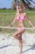 Sexy bikini model posing with a rope