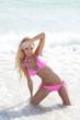 Bikini model posing in the water