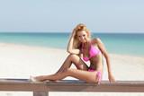 Beautiful model in a pink bikini
