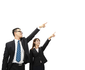 asian businessman and businesswoman pointing at something