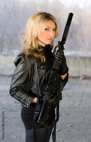 Pretty woman holding a gun