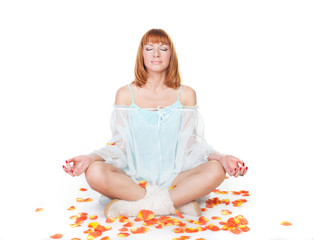 Woman in lotus position sitting on the floor