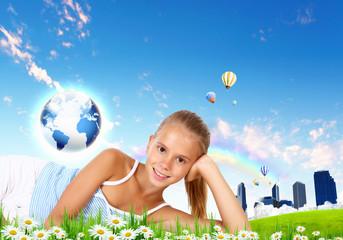 Smiling girl on green grass