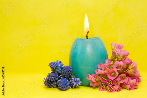 blue easter cande with   flowers