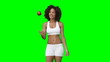 A woman in her training gear throwing and catching an apple