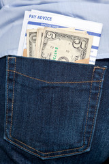 Money and payslip in back pocket.