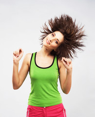 Lovely young woman having fun with shaking her hair