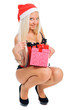 Sexy young blond woman wearing a corset and a Santa's hat with C