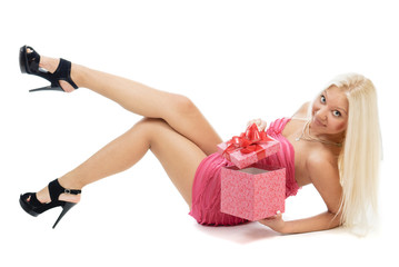 Beautiful sexy blonde woman in pink dress with red present box i