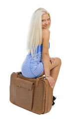 Beautiful blond traveler woman with a bag isolated on white back