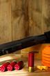 Leinwandbild Motiv 12 Gauge Shotgun, Shells, and Clay Pigeons
