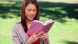 Brunette woman reading an interesting book