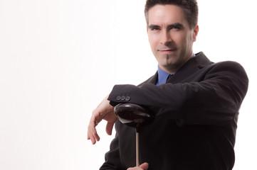 Businessmann mit Golfschläger