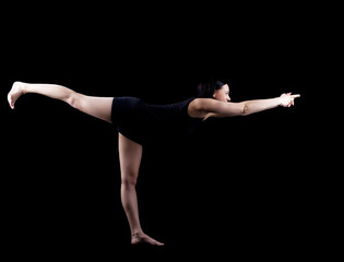 woman in dark exercise yoga balance asana