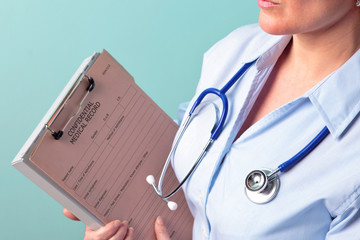 Female doctor holding medical record
