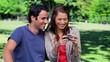 Smiling couple looking at a digital camera