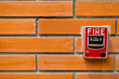 fire alarm on brick wall