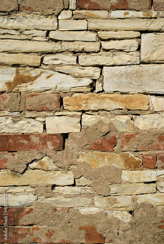 Close up of a brick and limestone stone wall.