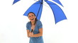 Happy woman with an umbrella