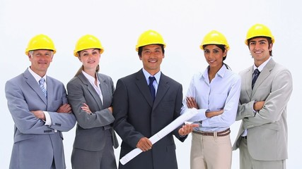 Business team wearing hardhats standing side by side
