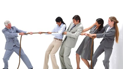 Business team playing Tug-of-War against their boss