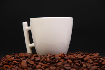 Cup with coffee. costing on coffee grain