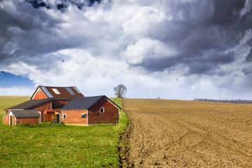 Farm with stormy sky