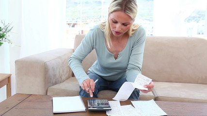 Blonde woman having financial problems