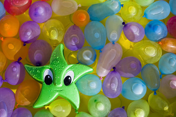 Toy star between colored ballons