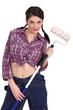 sexy craftswoman painter holding a roller brush