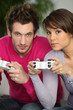 Man and woman playing video games