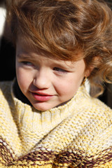 Little girl wearing knitted jumper