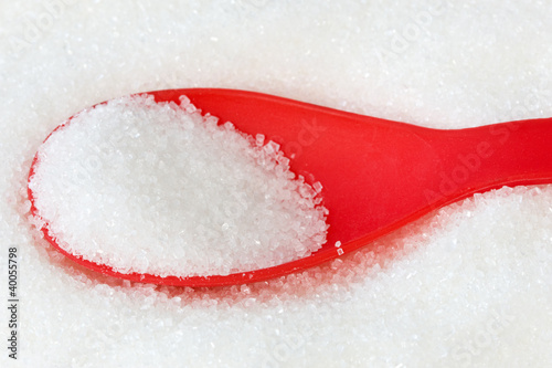 red spoon with sugar