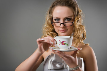 Beauty blondy model girl with glasses