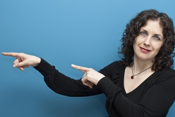 Woman pointing at something interesting