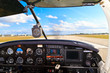 Cockpit view from small aircraft taking off from runway