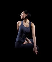 Beautiful yong woman sit in dark - yoga asana