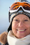 Mature woman in a trendy ski hat and mask