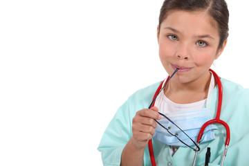 portrait of a little girl dressed as a nurse