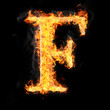 Fonts and symbols in fire on black background - F