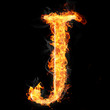 Fonts and symbols in fire on black - J