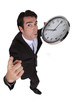 businessman in a hurry holding a huge clock