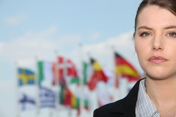 Portrait of woman in front of flags