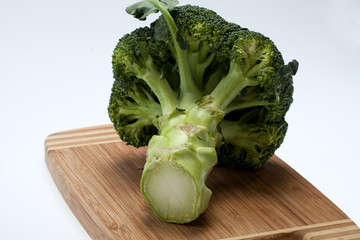 brocolli on the cutting board on the white background