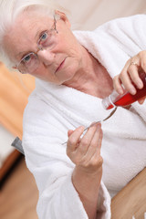 Old woman drinking cough syrup