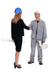 businesswoman and craftsman shaking hands
